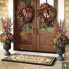 double wreaths for Fall with matching planters, love the front door