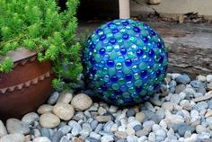 Glossy garden art using bowling balls Dot Baker's glowing blue and teal