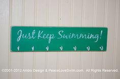 Just Keep Swimming Ribbon & Medal Display Rack - Wood Wall Mount with hooks.  Can be personalized!  Available from www.PeaceLoveSwim.com