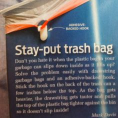 Use an upside-down command hook to hold your handled trash bag in place.