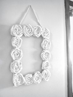 Rolled fabric rosette frame