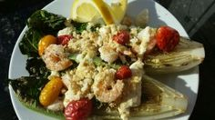 Grilled Shrimp Caesar with tomatoes and crumbtons