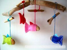 Roberta filava_filava:  [tutorial] Mobile of Fish made of felt covered rocks hanging from driftwood