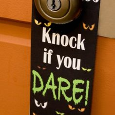 So simple and easy! Halloween Door Hanger - 40 Easy to Make DIY Halloween Decor Ideas