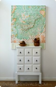 Love this map hung behind a small accent table.