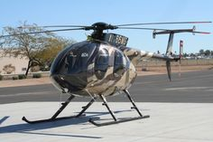 MD 500 in camo paint scheme. Beautiful.