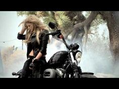 Supermodel Marissa Miller does a burnout on a Harley-Davidson