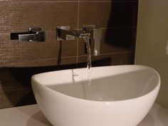 Wall mounted faucets and stylish vessel sink.