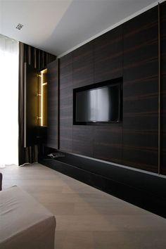 All about the wood paneling and built-in/flush-mounted flat panel. Knightsbridge Renovation, London. Designed by Rajiv Saini & Associates