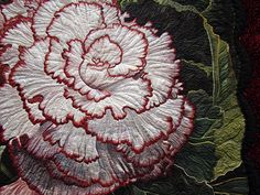 Pat Durbin used every scrap of  her twenty years of quilting experience to render the larger-than-life interpretation of Begonia Picotee Lace...