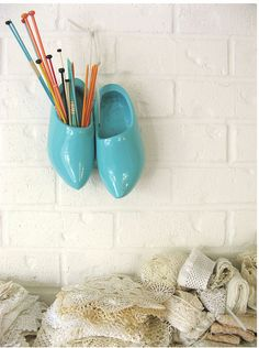 I have some wooden shoes...maybe I should do something like this rather than have them sit in my closet gathering dust!