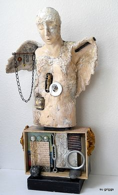 Su Griggs Allen - Clay on Mixed media - this artist calls herself a storyteller in clay and paint, which I like as a description