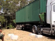 Shipping Container House - Placing the containers on foundations