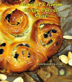 Almond  Raisin Cream Cheese Swirly Bread - Oh my! Cream cheese, ground almonds  raisins all rolled into soft, sticky, sweet buns, and then there's the wonderful gooey glaze! If you love sticky buns, you will LOVE these!