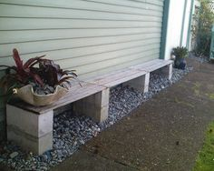 Simple cinder block bench to tie in wood planks with concrete block herb garden