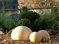fill old soccer/basketballs with cement, let dry, and use as decorations in the garden