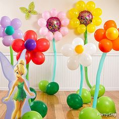 Create a forest of balloon flowers for your party pixies to play in! Click the pic for deets on making this magical meadow, plus lots more Tinker Bell party ideas.