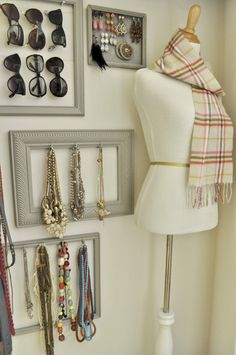 Painted frames to hang accessories and a dressmaker's dummy.