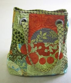 Modern quilted grommet bag. Interesting way to do handles