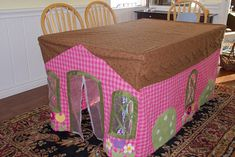 Tablecloth playhouse or fort. Store in a drawer when you're not using it. Might have to make one of these :)