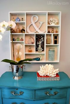 These perfume bottles are so pretty that when displayed in an open cabinet such as this one, they become part of the decor.