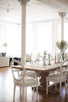 Nice dining table.  Maybe a different chair cushion color though... those white ones are not practical at all.