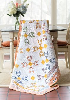 """Designer Jane Vaughan understands the ease of working with pre-cuts. Here she uses 2½""""-wide strips to create a classic block reminiscent of little flowers. Video tutorial available! Find this quilt in Quilting Quickly Fall '14."""