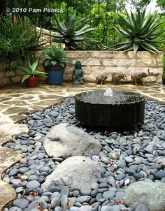 Gardening - Landscaping - Water Feature - fountain and  black star gravel Mexican beach pebbles