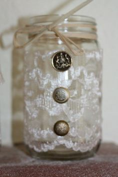 Glass candle holders jars for centerpieces at a wedding, bridal shower, etc. Vintage style. So cute!