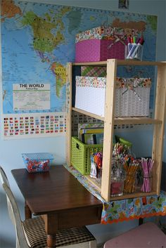 table divided by a shelf of materials, and you can never have too many maps in a homeschooling room
