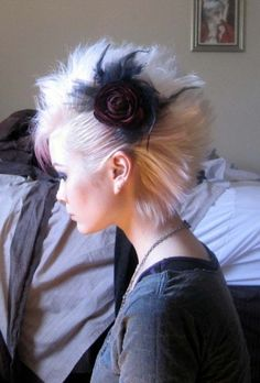 Cool bridal faux hawk. Can imagine this bigger with lots more flowers