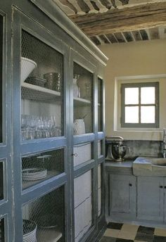 Chicken wire cabinet fronts