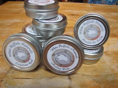 Herbal healing tin lip balm containers labeled with 100% Recycled White (RX) label material.