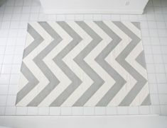 DIY Chevron Rug!! I want to do this on a rug for the living room or a canvas for over the fireplace. In yellow!
