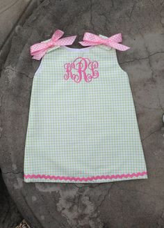 Monogrammed Baby and Girls summer beach dress made with green gingham and a 3 initial pink embroidered monogram