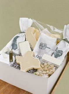 Make little favor bags/boxes with stuff meaningful to us. Personalized state cookies, things we enjoy, etc.