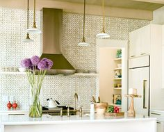 I love the wall of tile, as well as the 4 pendant lights -- unique!