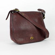 Coach 1970s leather satchel / eggplant purple stewardess bag / made in New York City. $145.00, via Etsy.