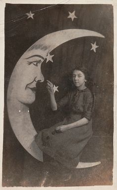 Girl with paper moon