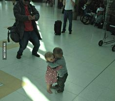 They had never met before, but decided to hug it out in the middle of an airport terminal