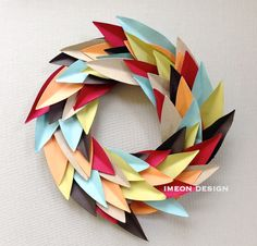 "This paper wreath, although small {6"" diameter to be exact}, is simply perfect to add in a child's room, narrow wall in the hallway or above the towel rack in you half bath.The wreath is hand cut from cardboard.  So that means the whole thing is recyclable! How fantastic is that?"