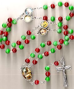 Share the festivity and joy of the holidays with this Christmas Nativity Rosary from Discount Catholic Products. Lovely red and green beads stud our rosary, shining in the colors of the Season. A full color image of the Nativity graces the rosary center, complimenting the 4 Our Father beads also featuring full color enamel illustrations.         Give these rosaries out as meaningful Christmas gifts to Catholic loved ones and friends.