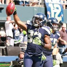 Jeron Johnson (32) celebrates after recovering a blocked punt and returning it for a touchdown. The Seahawks beat the Cowboys, 27-7. (Photo by John Lok / The Seattle Times)