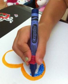 "Didn't read the article yet, but liked that the child appears to be using a ""Wiki-Stix"" or ""Bendaroo"" as a grip on the crayon. Also possible to use a rubber band."