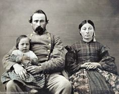 A Confederate soldier and his family during the Civil War era :)