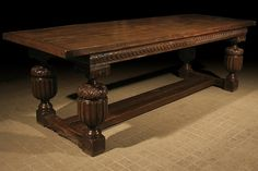 An Elizabethan Style (late C16th) Carved Oak Dining Table, handmade from old reclaimed oak.