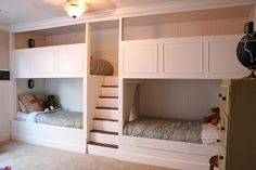 The two hinged boards on the bottom come up and you can pull out two trundle beds. So that makes a total of six twin beds in there.