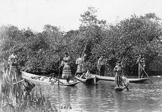 Seminole Indians with dugout canoes, Everglades National Park, 1921