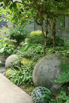 Concrete balls nestled in shade garden... / repinned on toby designs