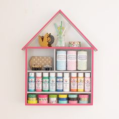 Make this cute and easy craft supply storage house out of a flatware organizer (you can find cheap ones at the thrift store).